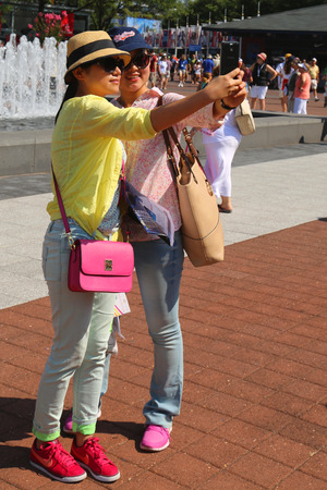 billie: NEW YORK - AUGUST 26 US Open 2014 visitors taking selfie at Billie Jean King Tennis Center on August 26, 2014 in NY