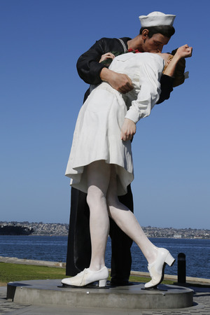 world war ii: SAN DIEGO, CALIFORNIA - SEPTEMBER 29: The Unconditional Surrender sculpture by Seward Johnson in the front of USS Midway in San Diego on September 29, 2014.