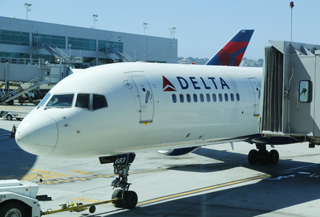california delta: SAN DIEGO, CALIFORNIA - SEPTEMBER 29: Delta aircraft at the gate at San Diego International Airport on September 29, 2014. Delta Air Lines and its subsidiaries operate over 5,000 flights every day Editorial
