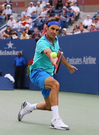 racket stadium: NEW YORK - September 6 Seventeen times Grand Slam champion Roger Federer during semifinal match at US Open 2014 against Marin Cilic at Arthur Ashe Stadium on September 6, 2014 in New York