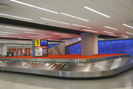 runways: NEW YORK- JULY 10: Baggage carousel in JetBlue Terminal 5 at JFK International Airport in New York on July 10, 2014. JFK is one of the biggest airports in the world with 4 runways and 8 terminals