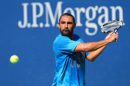 billie: NEW YORK - AUGUST 24: Professional tennis player Marcos Baghdatis from Cyprus practices for US Open 2014 at Billie Jean King National Tennis Center on August 24, 2014 in New York