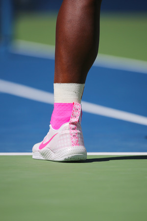 NEW YORK - AUGUST 28 Seventeen times Grand Slam champion Serena Williams wears custom Nike tennis shoes during match at US Open 2014 at Billie Jean King National Tennis Center on August 28, 2014 in NY