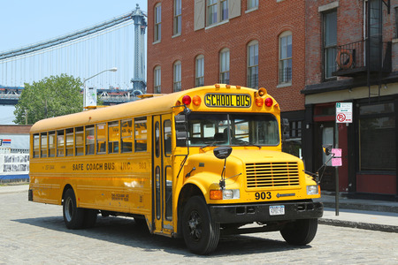 NEW YORK CITY-MAY 21: School bus in Brooklyn on May 21, 2013. NYC has the largest school transportation department in the country
