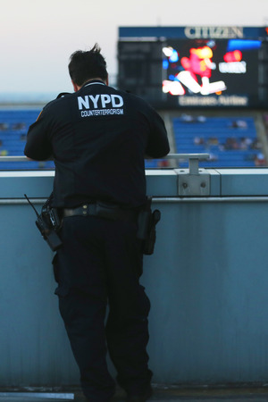 counter terrorism: NEW YORK - SEPTEMBER 2: NYPD counter terrorism officer providing security at National Tennis Center during US Open 2014 on September 2, 2014 in New York Editorial