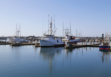 early thirties: SAN DIEGO - SEPTEMBER 29 - Famous San Diego Tuna fishing boats in San Diego Harbor on September 29, 2014. From the early thirties San Diego was known as the Tuna Capital of the World