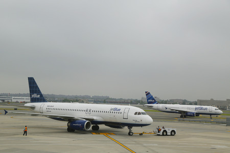 jetblue: NEW YORK- JUNE 10: JetBlue Airbus aircrafts taxing at John F Kennedy International Airport in New York on June 10, 2014. JetBlue Airways is an American low-cost airline with main base at JFK Airport