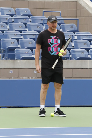 boris: NEW YORK - AUGUST 21: Six times Grand Slam champion Boris Becker coaching Novak Djokovic for US Open 2014 at Billie Jean King National Tennis Center on August 21, 2014 in New York