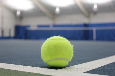 Tennis ball at indoor court photo