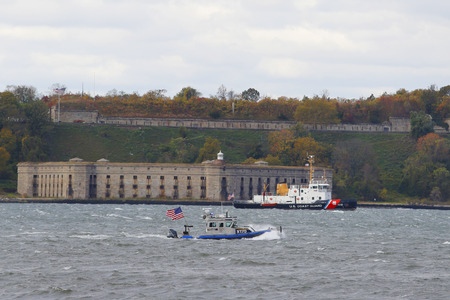 guard ship: NEW YORK - NOVEMBER 2: NYPD boat and US Coast Guard Ship providing security during New York City Marathon 2014 on November 2, 2014 in New York Harbor Editorial