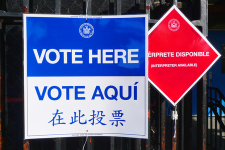 prohibits: NEW YORK - NOVEMBER 5: Signs at the voting site in New York on November 5, 2013.The Voting Rights Act of 1965 is a national legislation in the United States that prohibits discrimination in voting