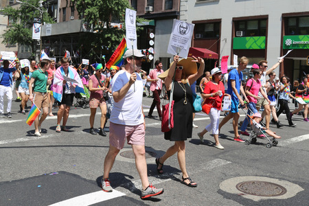 sexual orientation: NEW YORK - June 29, 2014: Russian-Speaking American LGBT Pride Parade participants with anti Putin signs in New York  on June 29, 2014.