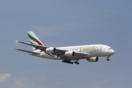 world   s largest: NEW YORK -JULY 8: Emirates Airline Airbus A380 in New York sky before landing at JFK Airport on July 8, 2014. The Airbus A380 is a double-deck, wide-body, world s largest passenger airliner
