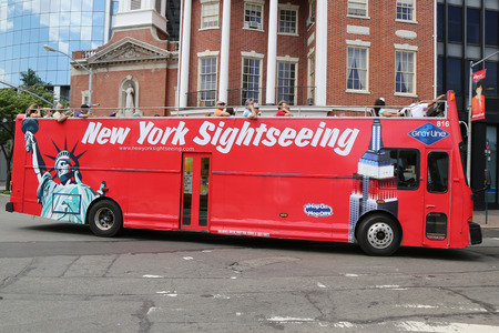 NEW YORK - JUNE 24:New York Sightseeing Hop on Hop off bus in Manhattan on June 24, 2014. Since 1926, Gray Line New York is the source for best double decker bus and deluxe motor coach tours