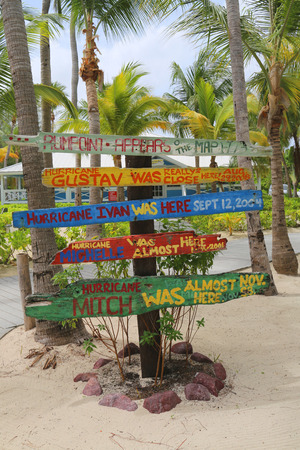 caribbeans: GRAND CAYMAN - JUNE 12: Signpost at Rum Point indicating major Hurricanes effecting Caribbeans and Cayman Islands on June 12, 2014