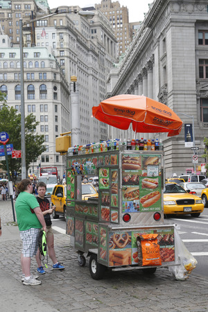 NEW YORK - JULY 24: Street vendor cart in Manhattan on July 24, 2014. There are about 4,000 mobile food vendors licensed by the city