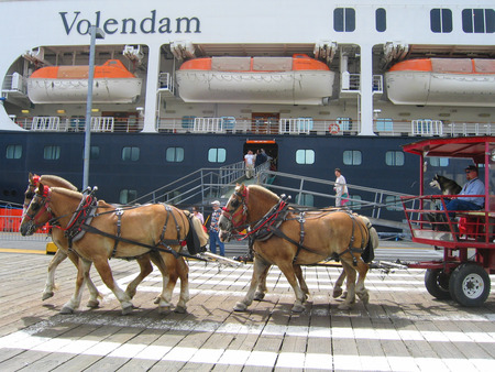 KETCHIKAN, ALASKA - JULY 26: Horse drawn carriage tour in the front of the Volendam Holland America Cruise ship in Ketchikan on July 26, 2004