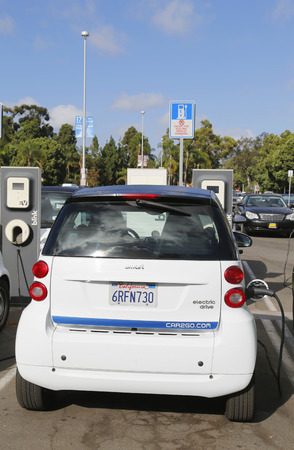 SAN DIEGO, CALIFORNIA - SEPTEMBER 28 Car2go car parked at Electric Car charging station and ready to hire at Balboa Park in San Diego on September 28, 2014