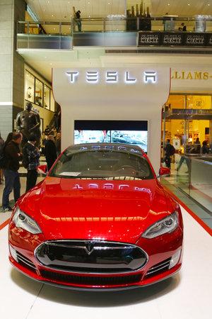 warner: NEW YORK  - OCTOBER 12: Tesla electric sports car on display at Time Warner Center in Manhattan on October 12, 2014.