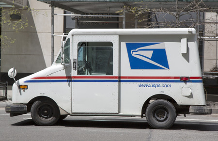 united states postal service: NEW YORK - MAY 6 United States Postal Service van in New York on May 6, 2014. The  US Postal Service is an independent agency of the US federal government providing postal service in the United States Editorial