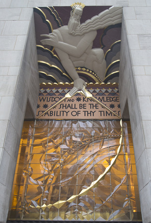 general knowledge: NEW YORK CITY - JANUARY 26: Wisdom, an art deco frieze by Lee Lawrie over the entrance of GE Building at Rockefeller plaza on January 26, 2014 Editorial