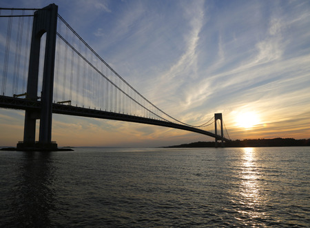 boroughs: NEW YORK - NOVEMBER 9: Verrazano Bridge in New York on November 9, 2014.The Verrazano Bridge is a double-decked suspension bridge that connects the boroughs of Staten Island and Brooklyn
