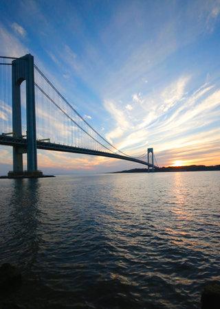 boroughs: NEW YORK - NOVEMBER 9: Verrazano Bridge in New York on November 9, 2014.The Verrazano Bridge is a double-decked suspension bridge that connects the boroughs of Staten Island and Brooklyn