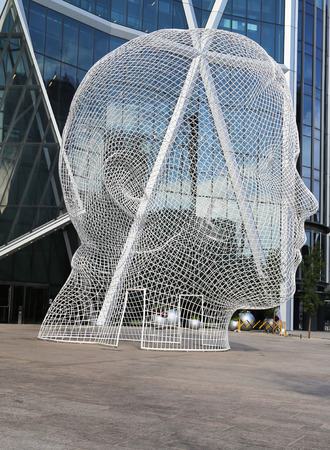 CALGARY, CANADA - JULY 29: Wonderlan sculpture by  Jaume Plensa in the front of the Bow Tower on July 29, 2014 in Calgary, Alberta, Canada. Jaume Plensa is a Catalan Spanish artist and sculptor