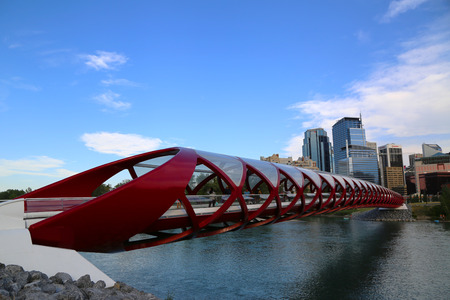 CALGARY, CANADA - JULY 29: The Peace Bridge on July 29, 2014 in Calgary, Alberta, Canada. The pedestrian bridge spans the Bow River and was designed by Santiago Calatrava