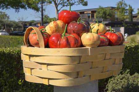 silverado: YOUNTVILLE, CALIFORNIA - APRIL 13: Abundance  or tomato basket by Peter Hazel at art walk on April 13, 2014 in Yountville, California