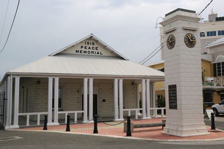 reign: GRAND CAYMAN - JUNE 12: 1919 Peace Memorial Building and clock tower commemorating the reign of King George V at George Town on June 12, 2014