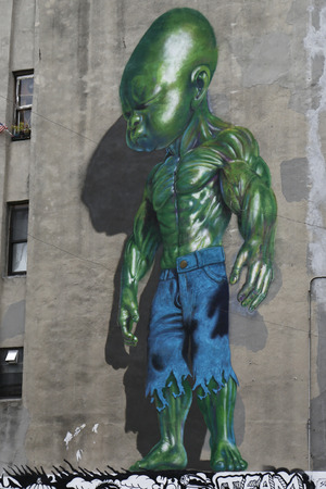 NEW YORK - NOVEMBER 16: Mural art in Little Italy in Manhattan on November 16, 2014. A mural is any piece of artwork painted or applied directly on a wall, ceiling or other large permanent surface Sajtókép