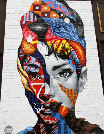 NEW YORK - NOVEMBER 16: Mural art in Little Italy in Manhattan on November 16, 2014. A mural is any piece of artwork painted or applied directly on a wall, ceiling or other large permanent surface Editorial