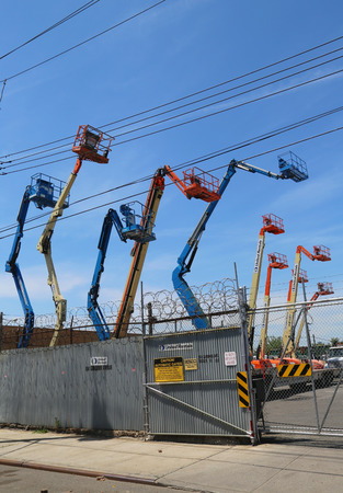 rentals: BROOKLYN, NY - JUNE 1: Boom Lifts at United Rentals location in Brooklyn on June 1, 2014. United Rentals is the largest equipment rental company in the world,with network of 880 rental locations