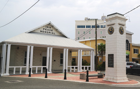 reign: GRAND CAYMAN - JUNE 12: 1919 Peace Memorial Building and clock tower commemorating the Reign of King George V at George Town on June 12, 2014 Editorial