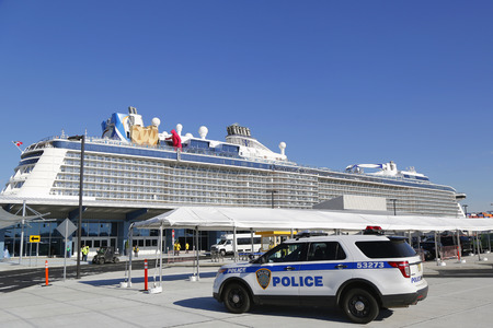 caribbean cruise: BAYONNE, NEW JERSEY- NOVEMBER 18:Port Authority Police New York New Jersey providing security for Royal Caribbean Cruise Ship Quantum of the Seas docked at Cape Liberty Cruise Port on November 18, 2014