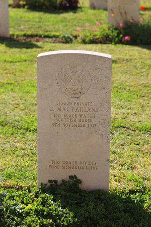 israel war: BEER SHEBA, ISRAEL - NOVEMBER 28: Gravestone of fallen The Black Watch Scottish  Horse private at Beer Sheba War Cemetery on November 28, 2014