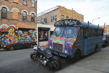 NEW YORK - NOVEMBER 4: Music Wagon covered with graffiti in Brooklyn on November 4, 2014. Outdoor art gallery known as the Bushwick Collective has most diverse collection of street art in Brooklyn