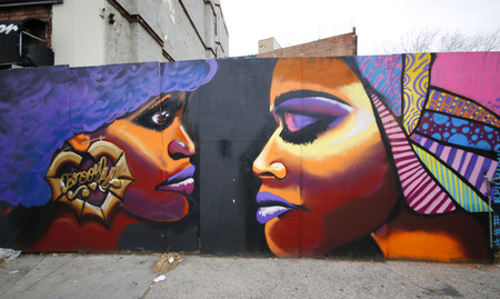 NEW YORK - DECEMBER 14: Mural art at Prospect Heights neighborhood in Brooklyn on December 14, 2014. A mural is any piece of artwork painted or applied directly on a wall or other permanent surface. Sajtókép