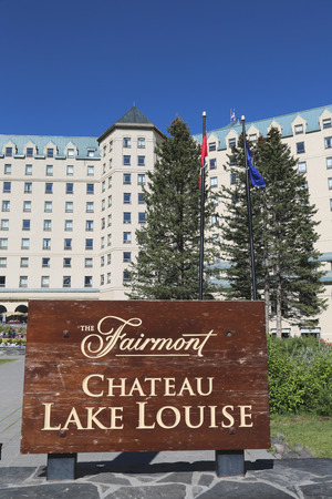 louise: LAKE LOUISE, CANADA - JULY 27: View of the famous Fairmont Chateau Lake Louise Hotel on July 27, 2014. Lake Louise is the second most-visited destination in the Banff National Park Editorial