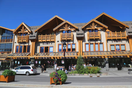 banff: BANFF, CANADA - JULY 29: Shops at the famous Banff Avenue in Banff National Park on July 29, 2014. Banff is a resort town and one of Canada s most popular tourist destinations