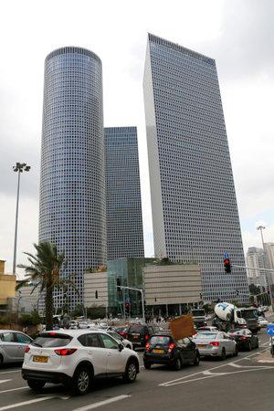 azrieli: TEL AVIV, ISRAEL - NOVEMBER 25 : Tel Aviv street view with Azrieli Center buildings on November 25, 2014. Azrieli center is the symbol of Tel Aviv