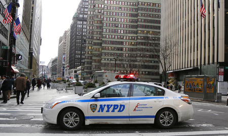 new world order: NEW YORK - DECEMBER 18 NYPD car providing security at Times Square area on December 18, 2014. New York Police Department, established in 1845, is the largest police force in USA