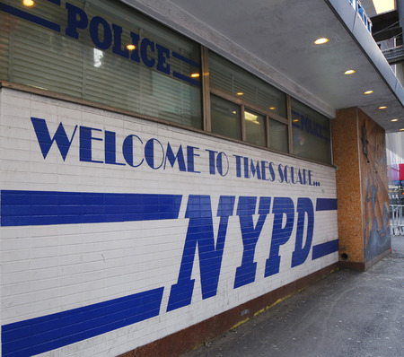 new world order: NEW YORK - DECEMBER 18 Sign at the famous NYPD Times Square Precinct in Midtown Manhattan on December 18, 2014 Editorial