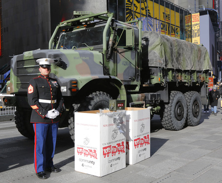 u s: NEW YORK - DECEMBER 18: U. S. Marine during U.S Marine Corps Reserve Toys for Tots Program collection at the Times Square on December 18, 2014 in midtown Manhattan