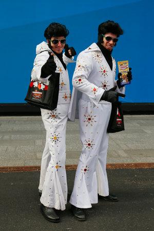 elvis presley: NEW YORK - DECEMBER 18: Only in New York. Unidentified street performers dressed as Elvis Presley at Times Square in Midtown Manhattan on December 18, 2014. Editorial