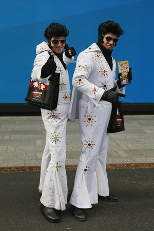 NEW YORK - DECEMBER 18: Only in New York. Unidentified street performers dressed as Elvis Presley at Times Square in Midtown Manhattan on December 18, 2014. Stock fotó - 34844945