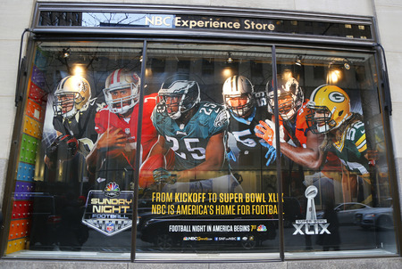 super bowl: NEW YORK - DECEMBER 18: NBC Experience Store window display decorated with NFL and Super Bowl XLIX logos in Rockefeller Center in Midtown Manhattan on December 18, 2014 Editorial