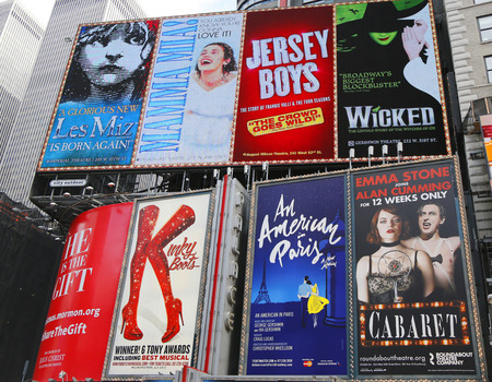 NEW YORK - DECEMBER 18: Broadway signs in Manhattan on December 18, 2014. With over 40 prominent theater houses, Broadway theater is considered one of the world s highest levels of commercial theater
