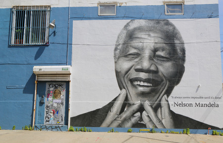mandela: NEW YORK - JUNE 21: Nelson Mandela mural in Williamsburg section in Brooklyn on June 21, 2014. This mural does not exist any more Editorial